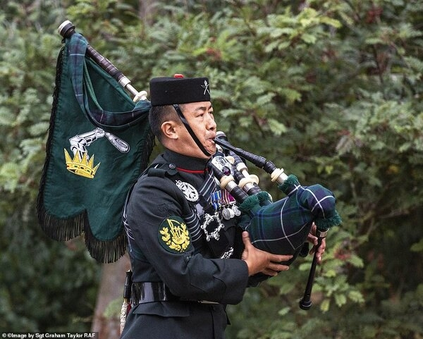 31976994-8629471-Image_shows_Colour_Sergeant_Lil_Bahadur_Gurung_playing_the_pipes-a-28_1597482...jpg