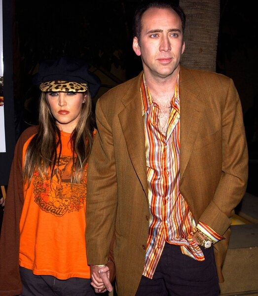 Lisa-Marie-Preslely-with-Nicolas-Cage-Rolex-Moonphase.jpg