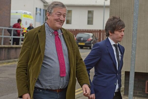 Stephen-Fry-and-his-fianc-Elliott-Spencer-leave-Cwmbran-Magistrates-Court-in-South-Wales.jpg